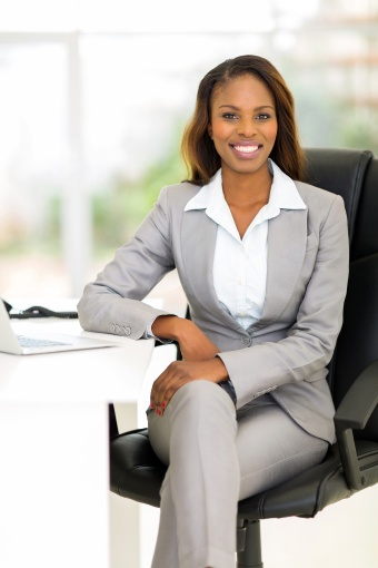 african female business executive in office